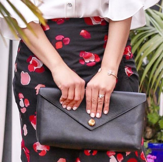 Spring with the FLORENECE Envelope Clutch in Black.