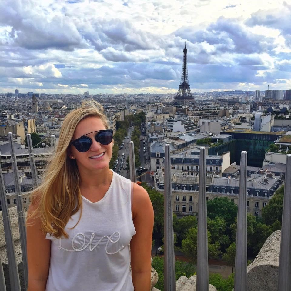 Erica Watson reaches the top of the Arc de Triomphe on a trip to Paris.