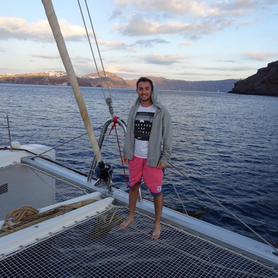 Matt Richardson stands atop a catamaran on his trip to Santorini, Greece.