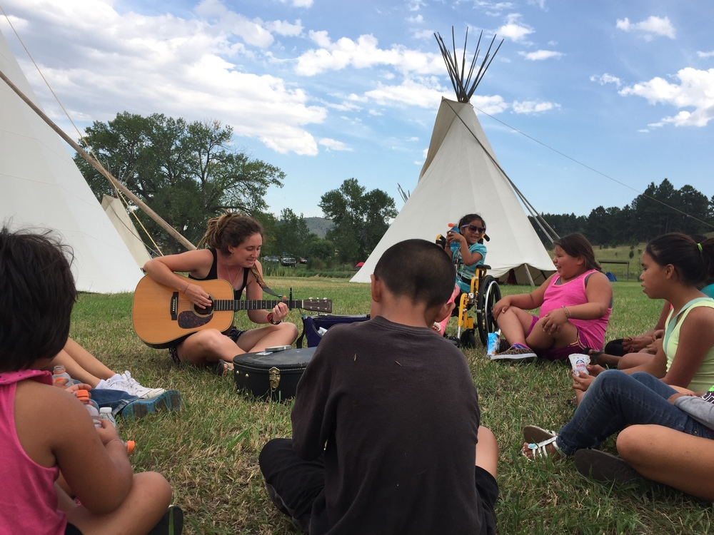 Practicing out behind the tipis before taking the stage!