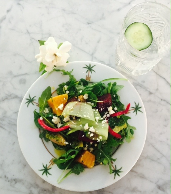 Spinach & Arugula Salad with red & yellow beets, brussel sprouts, walnuts, goat cheese and cucumber with lemon juice and flaxseed oil dressing served on Philippe Deshoulieres Maldives pattern
