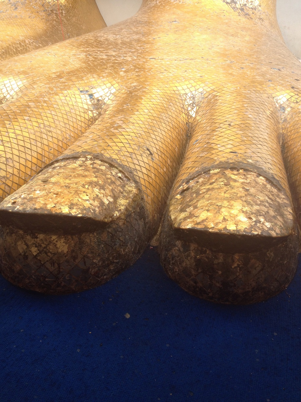 Giant gold toenails