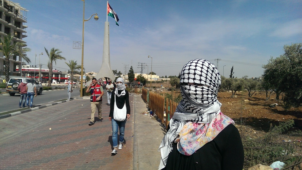 Kuffiyeh clad female protesters at anti-occupation demonstration by the Bet El settlement near Ramallah (PHOTO: Lena Odgaard)