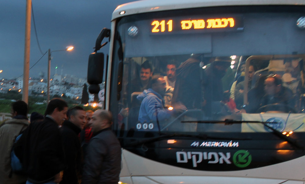 20130305 - Palestinian workers board bus cropped.jpg