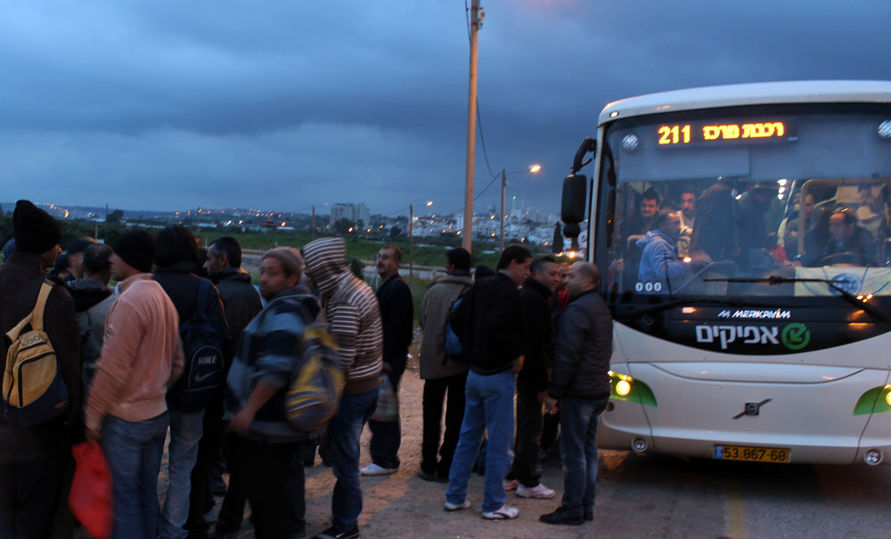 20130305 - Palestinian workers board bus.jpg