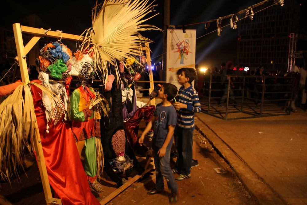 kids check out decorations at Circus Festival.JPG
