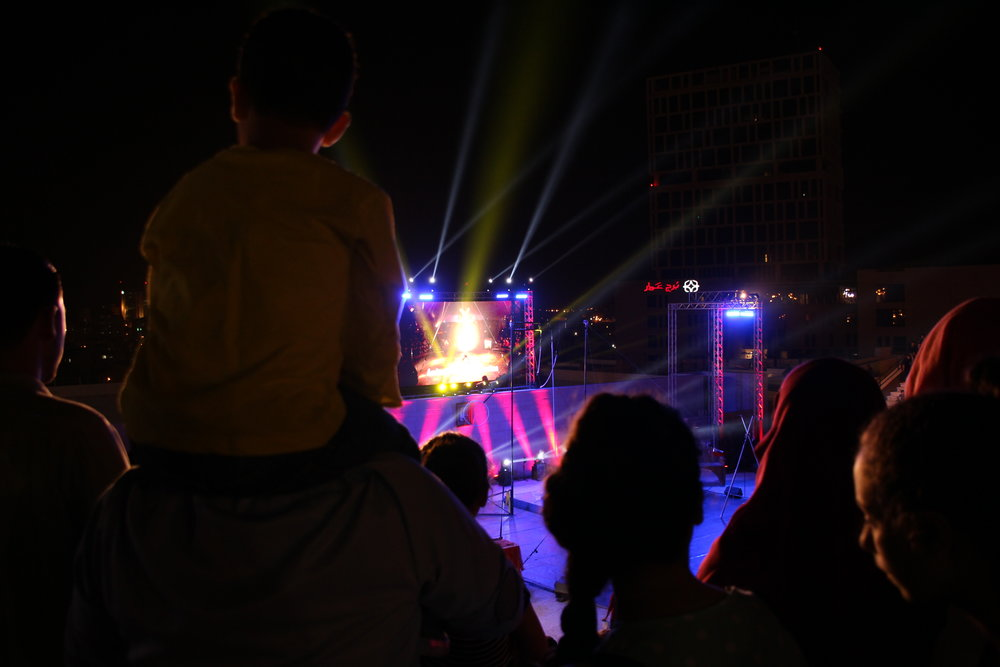 boy on shoulders at Circus festival.JPG