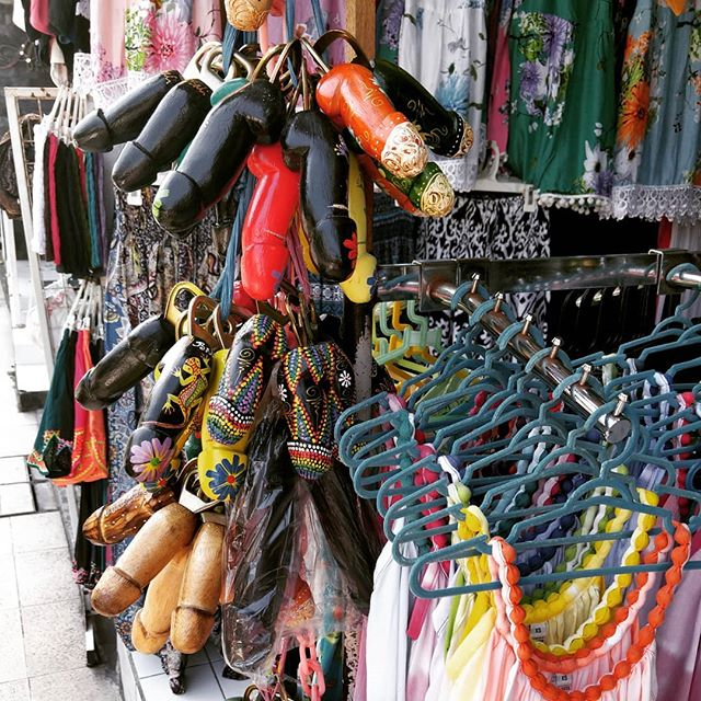 #Souvenir from #Bali anyone? Most of the souvenir shops in #seminyak sell colorful variations of this potent bottle opener. #phallus #inappropriatesouvenier #penisart #worldtraveler #discoverBali