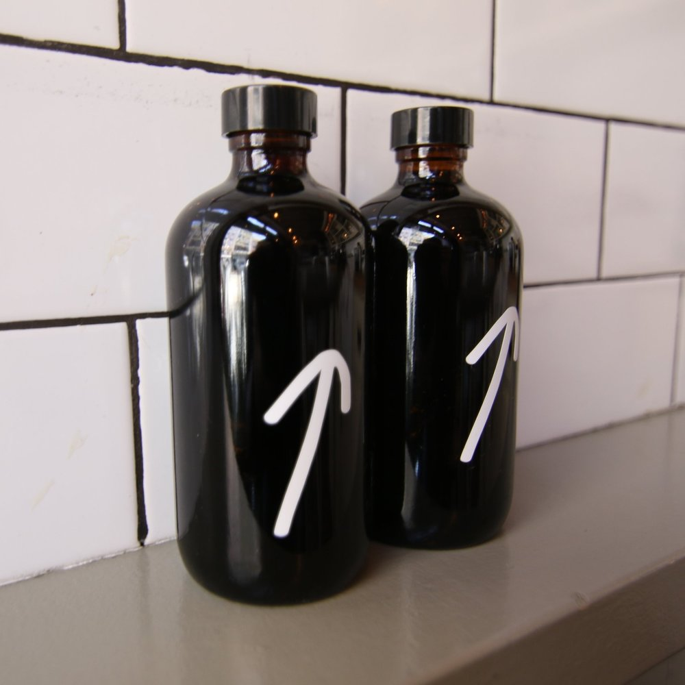 Cold brew bottles for sell at events and in-house at The Fat Radish.
