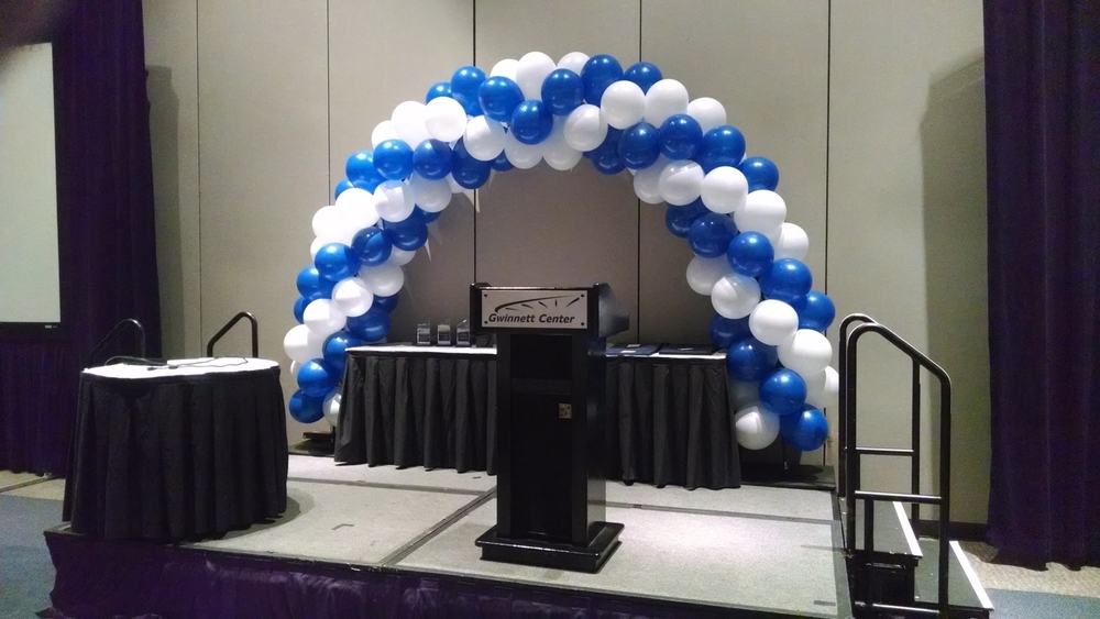 Balloon decor on stage at the Gwinnett Center