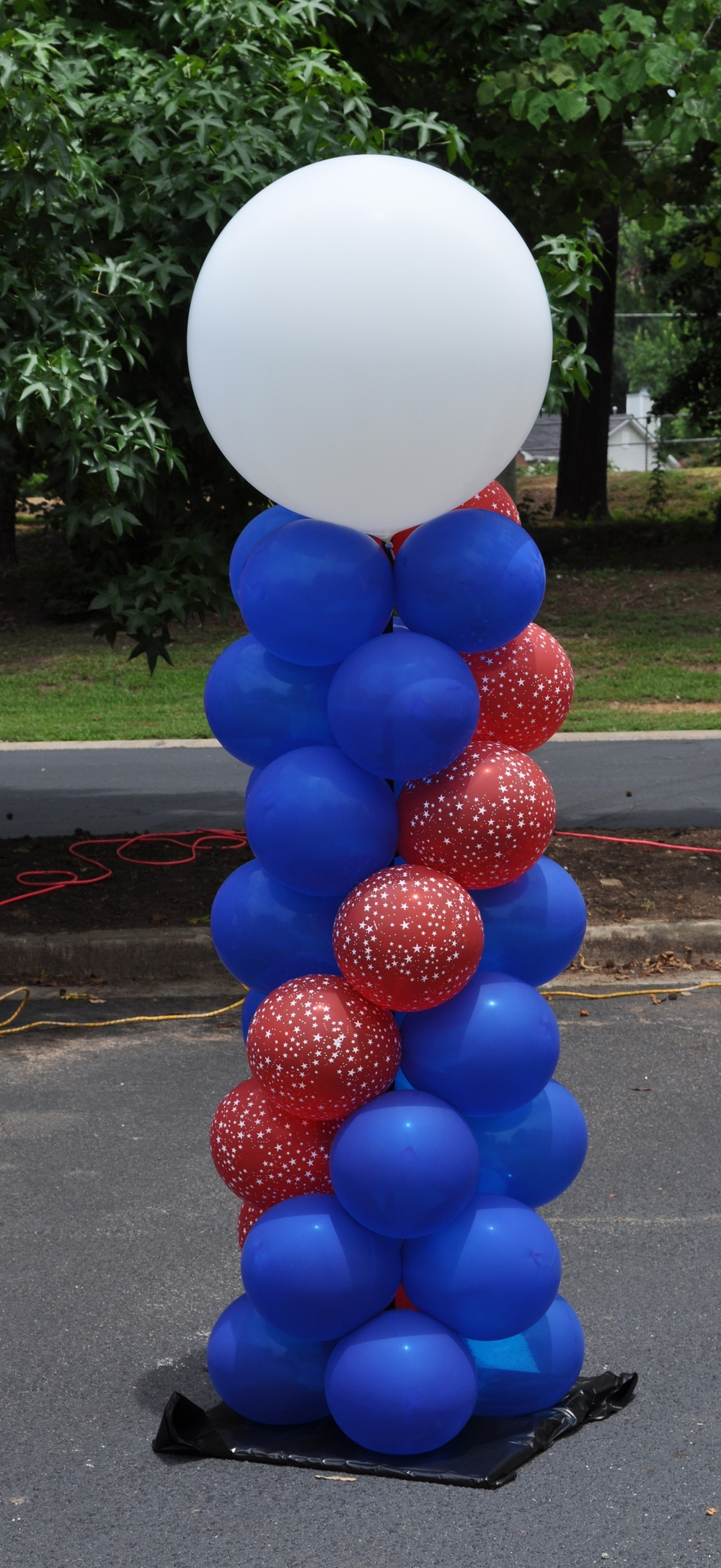 Red white and blue outdoor balloon column