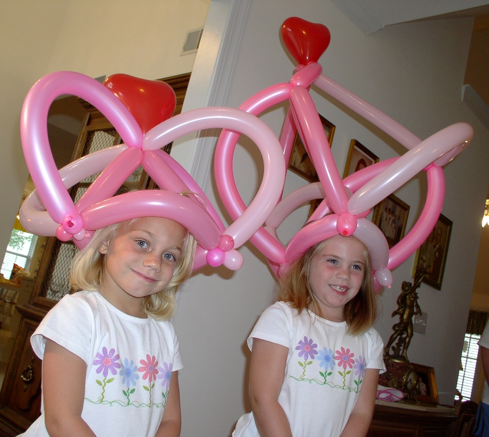 Pink balloon hats