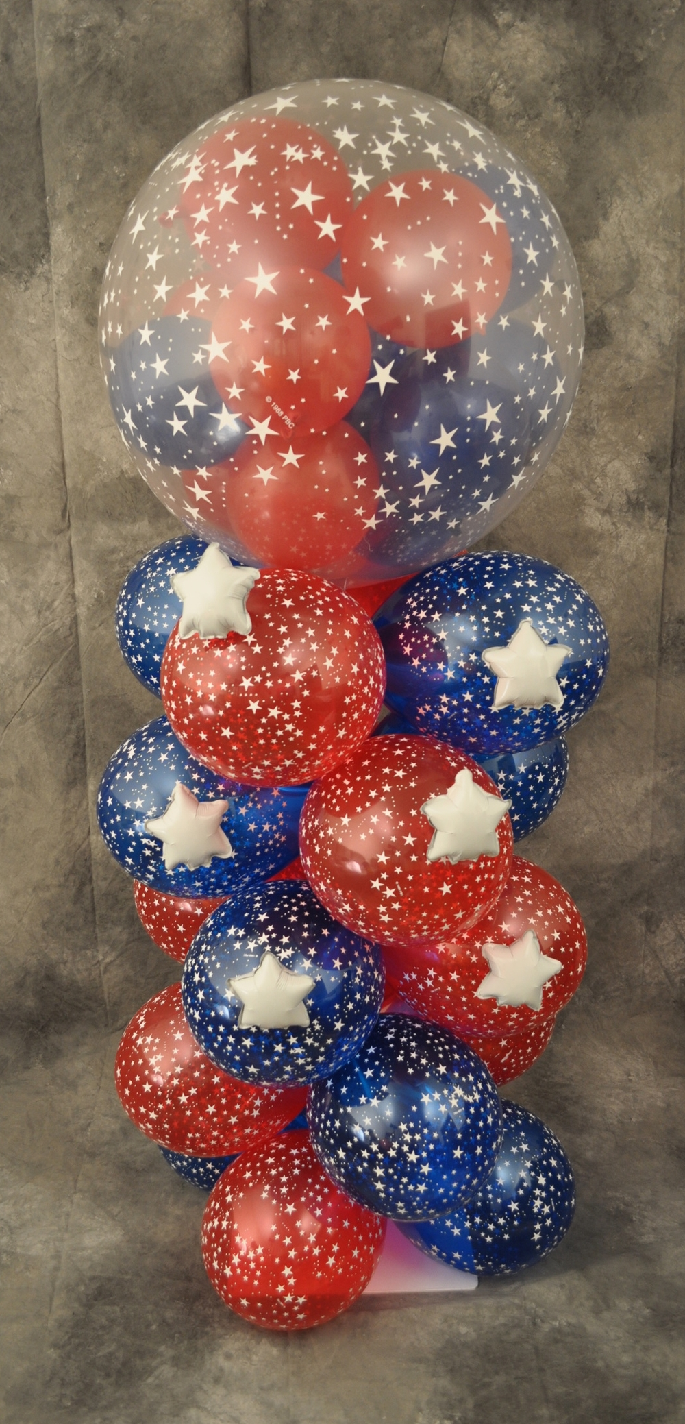Red white and blue balloon column