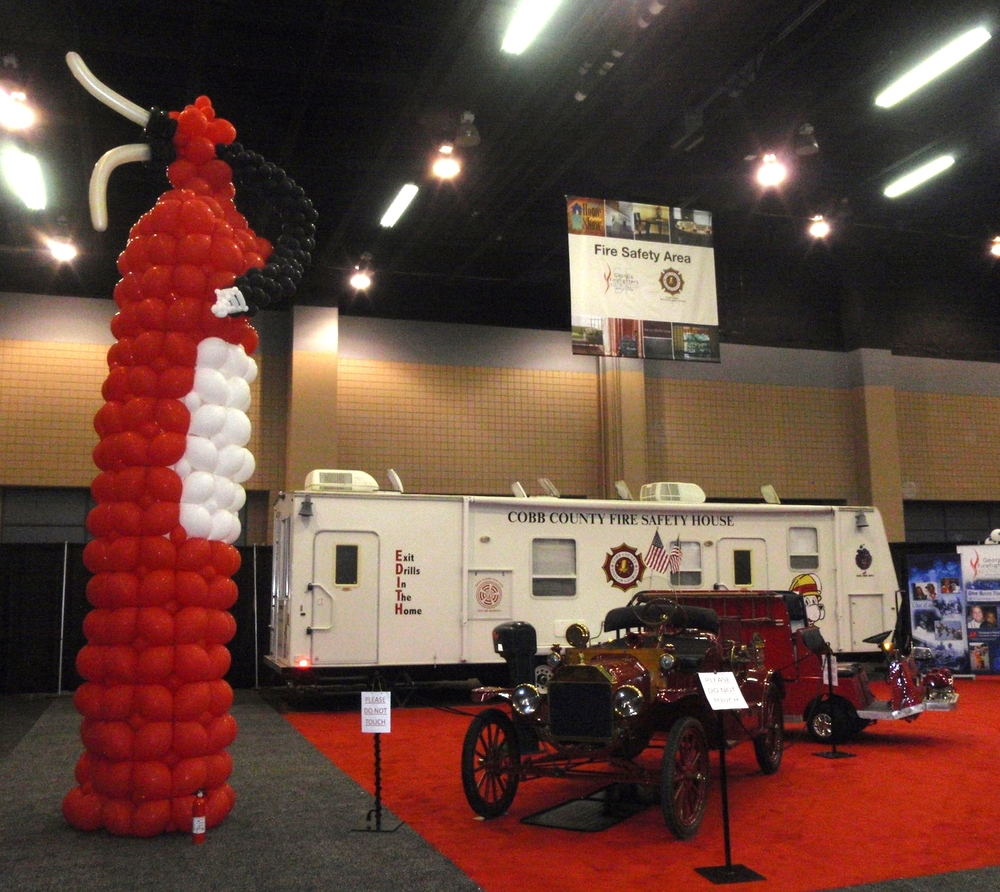 Fire safety center with giant balloon fire extinguisher