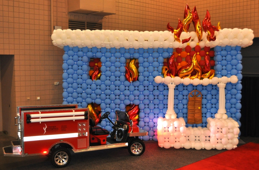 Burning house backdrop for fire truck