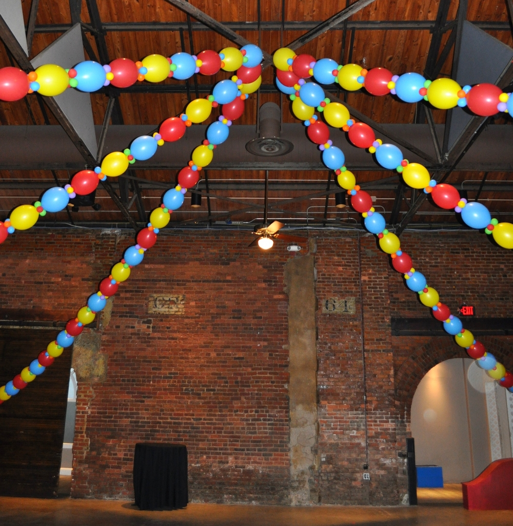 Circus-themed prom balloon big-top dance floor
