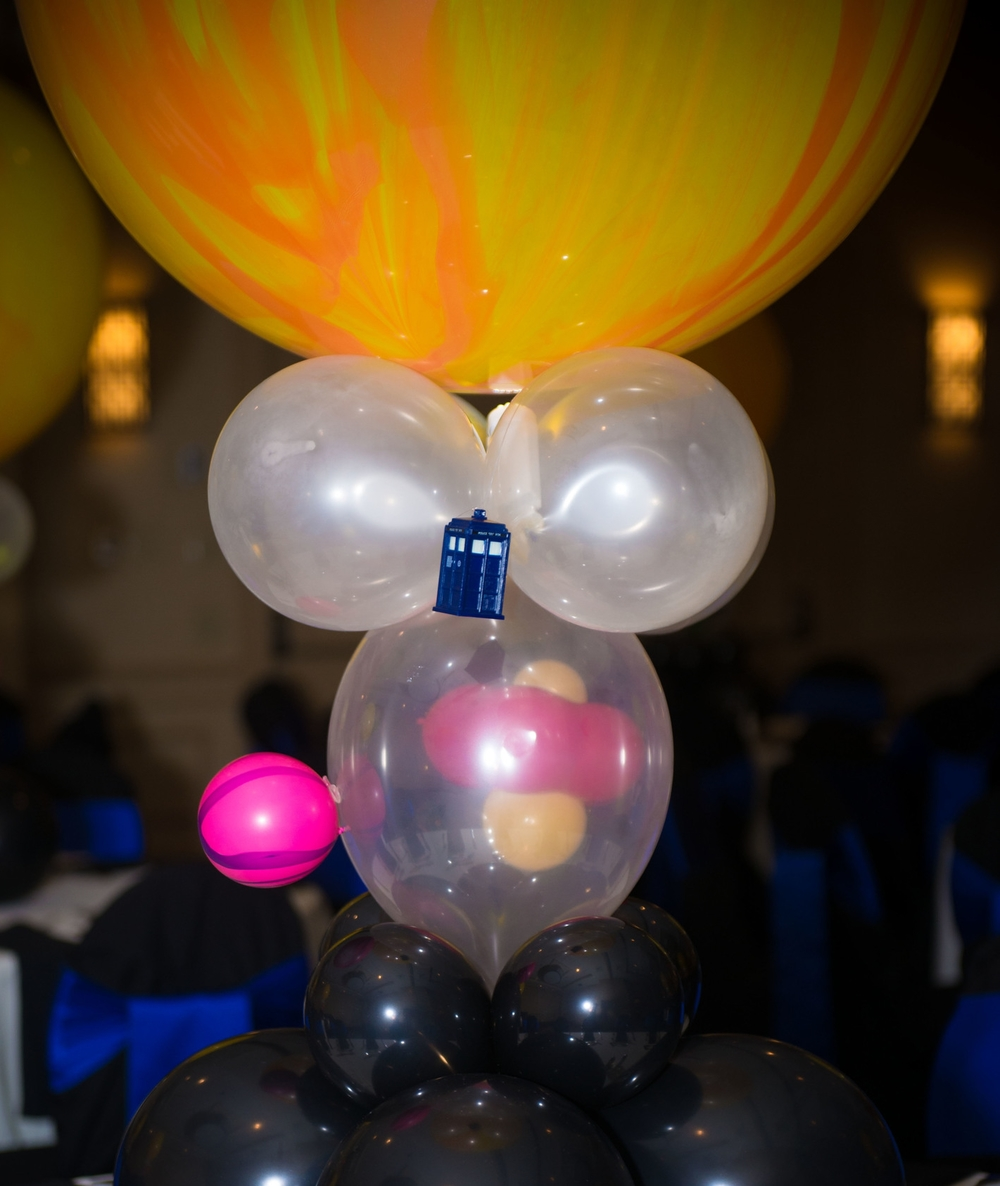 Doctor Who Bar Mitzvah balloon centerpieces - each with illuminated Tardis in orbit