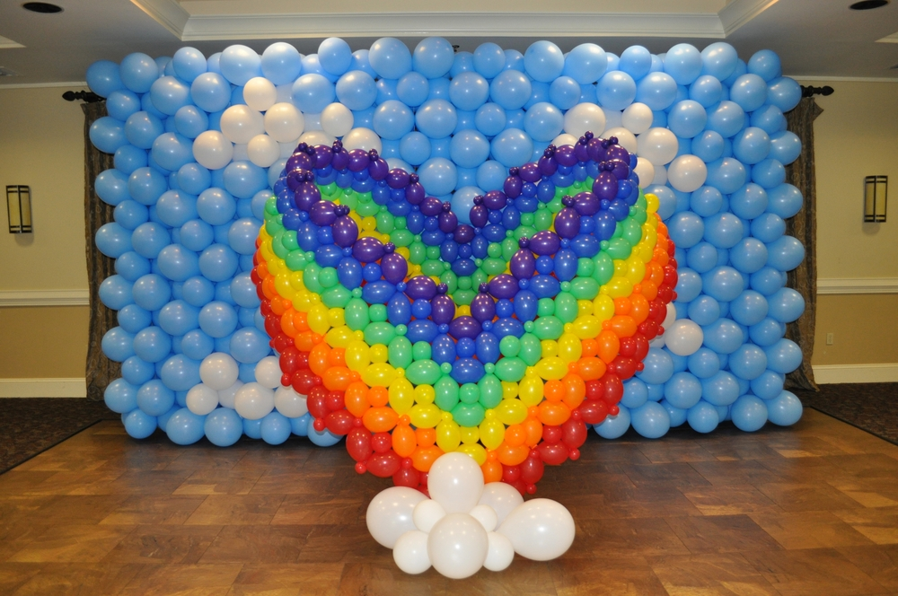 Rainbow heart balloon sculpture photo backdrop