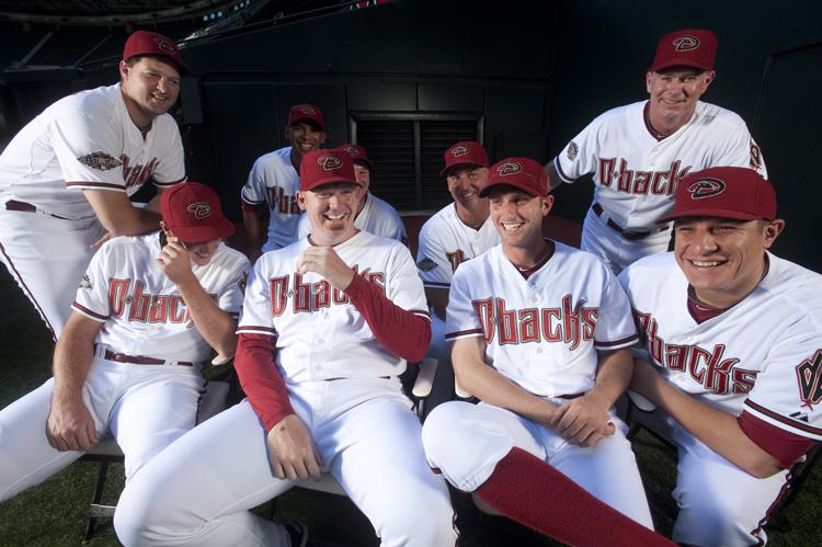 {date} {time} -- Phoenix, AZ, U.S.A -- Arizona Diamondbacks pitcher J.J. Putz, center, is surrounded by the entire Arizona Diamondbacks' bullpen.  From left back row:  --