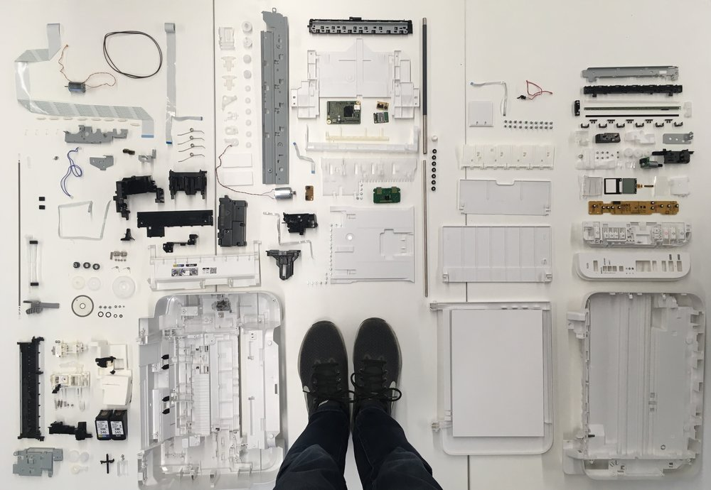 Flat lay of all the components of the printer