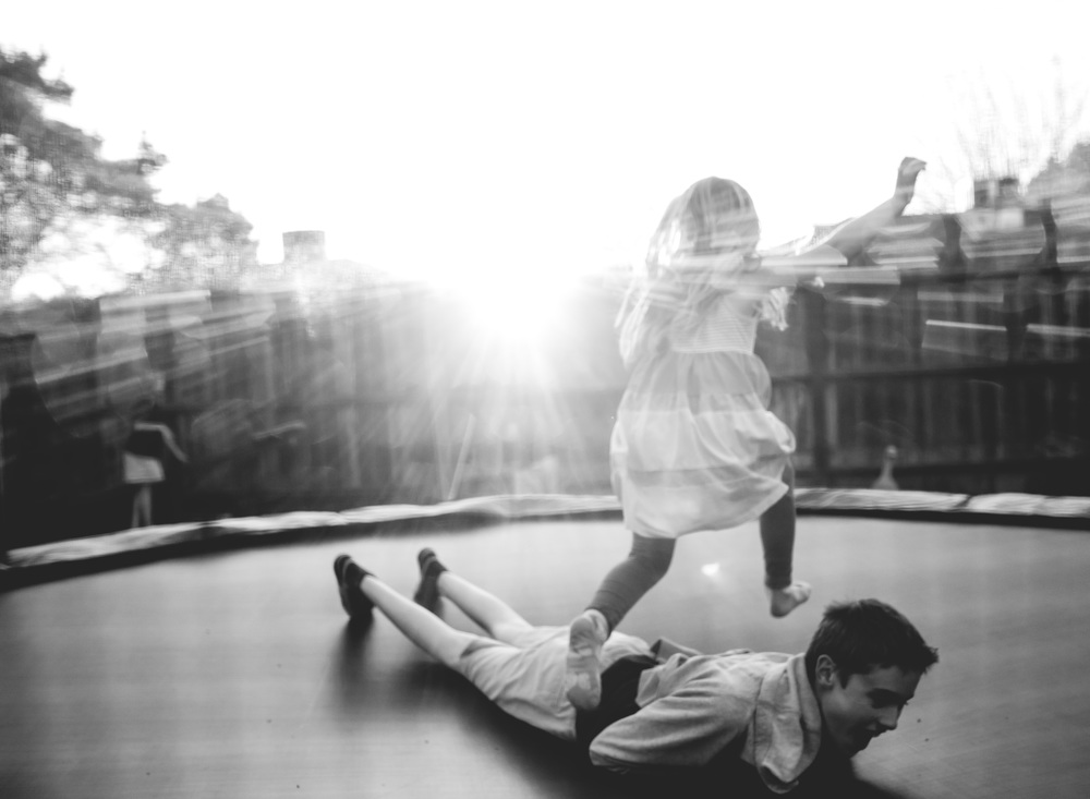 Jumping on the trampoline at sunset - personal life photography