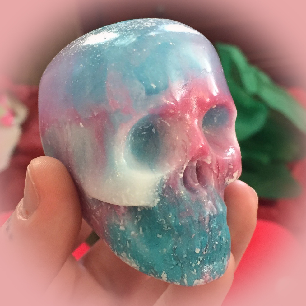 Wicked cool resin skull I made for a gift. With ghost hand.