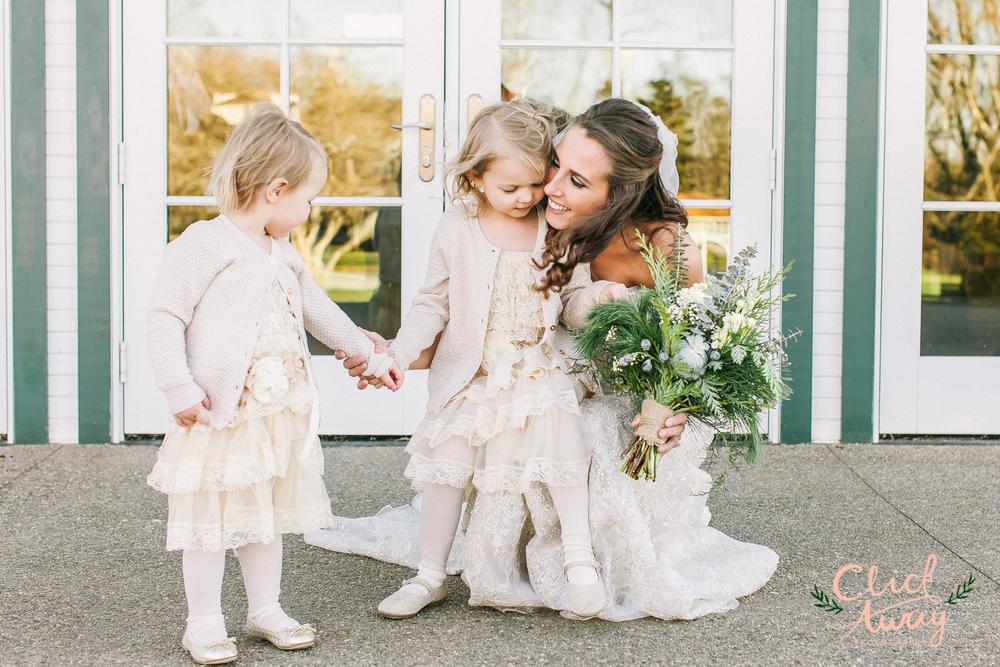 bride with flower girls