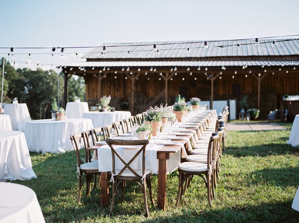 table setting at farmhouse wedding reception