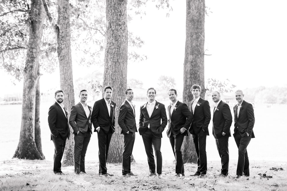groom with groomsmen in black and white
