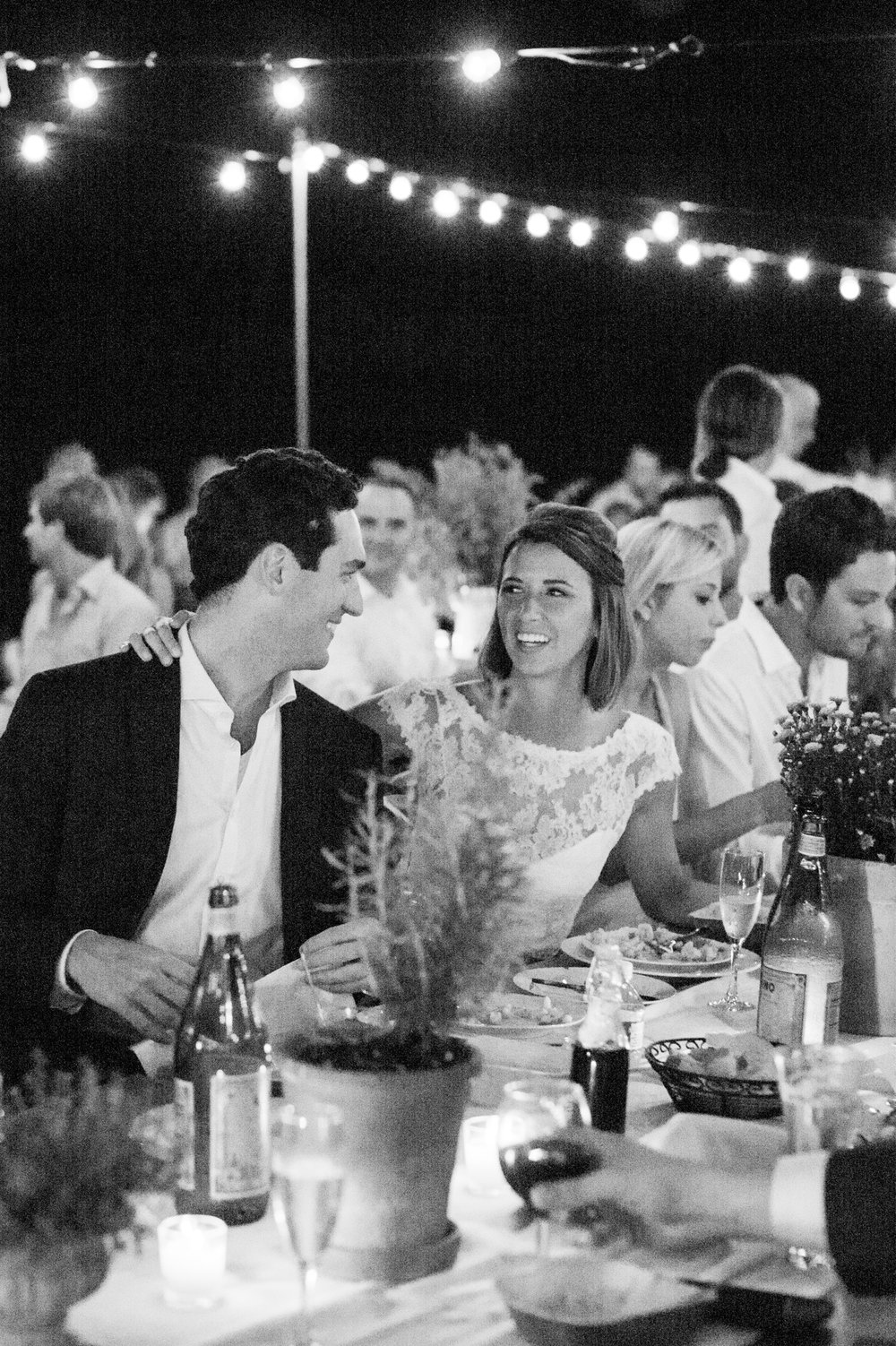 bride and groom during toasts in black and white