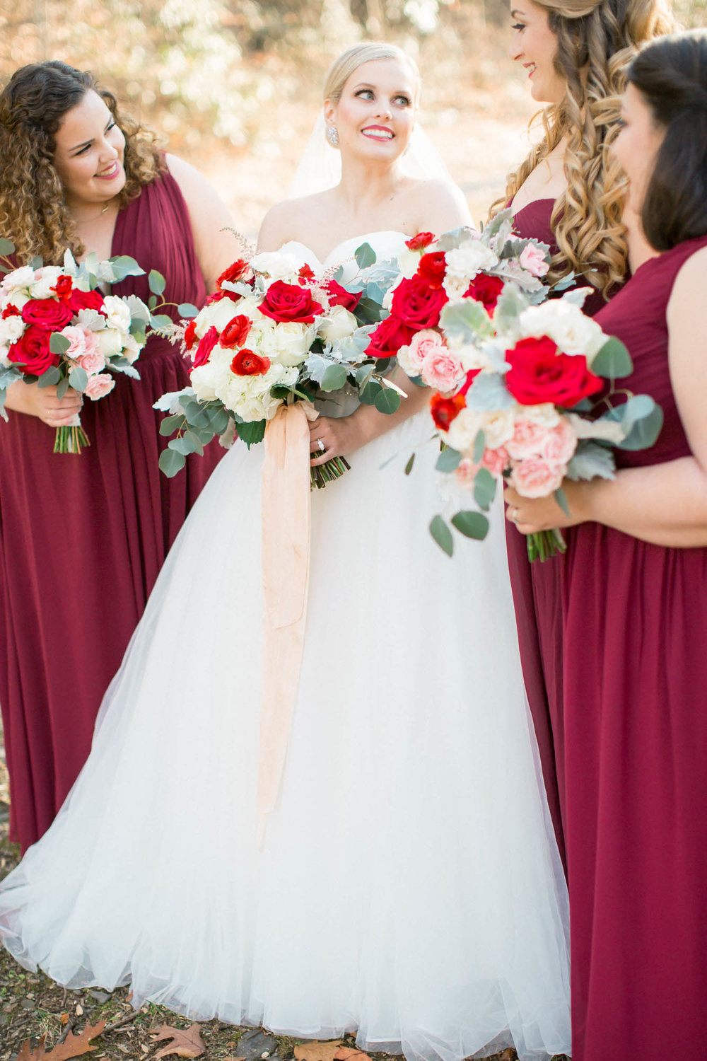 Bridesmaids and bride red and white bouquets