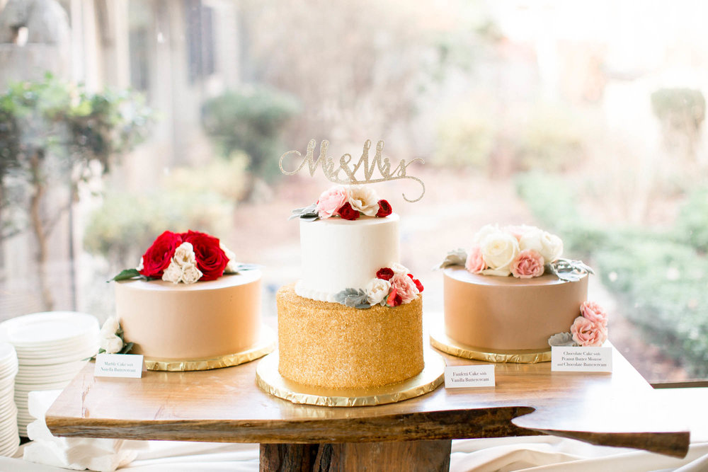 Wedding cake on wood cake stand