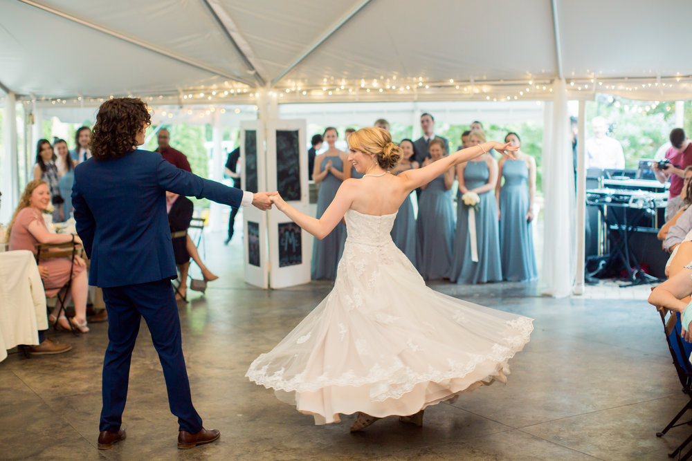 bride twirls in lace wedding dress