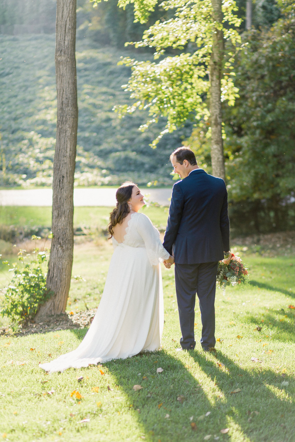 bride and groom at johnson carriage house