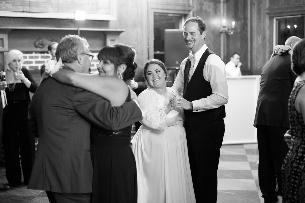 bride and groom and parents dance