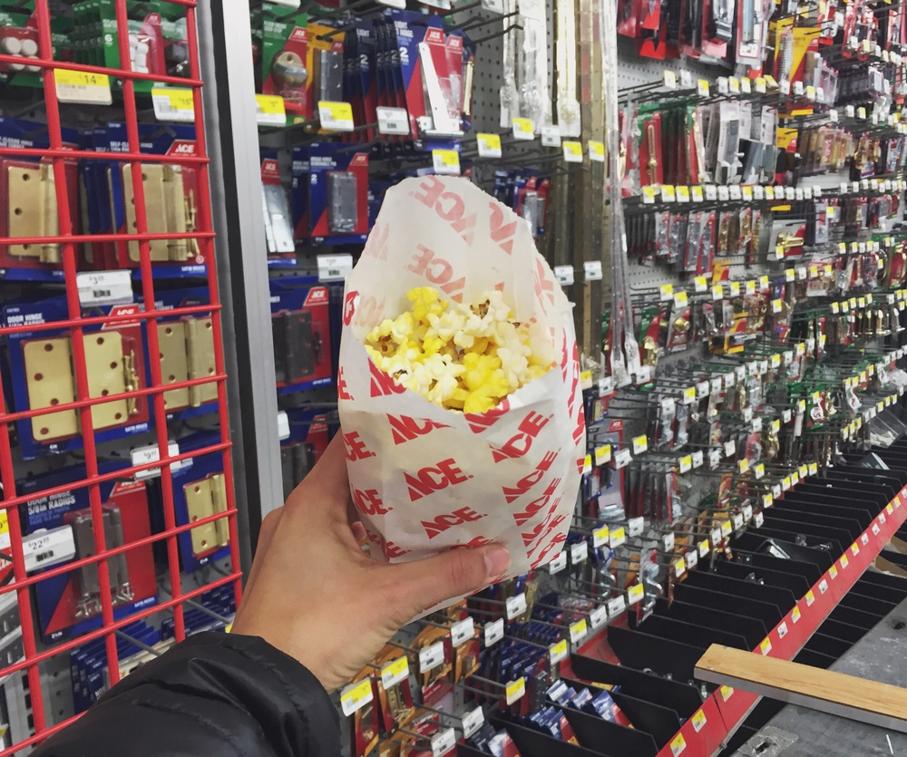 You know those social media darlings holding their ice cream or coffee's in front of a wall? This my Ace Hardware Gives You Popcorn version.
