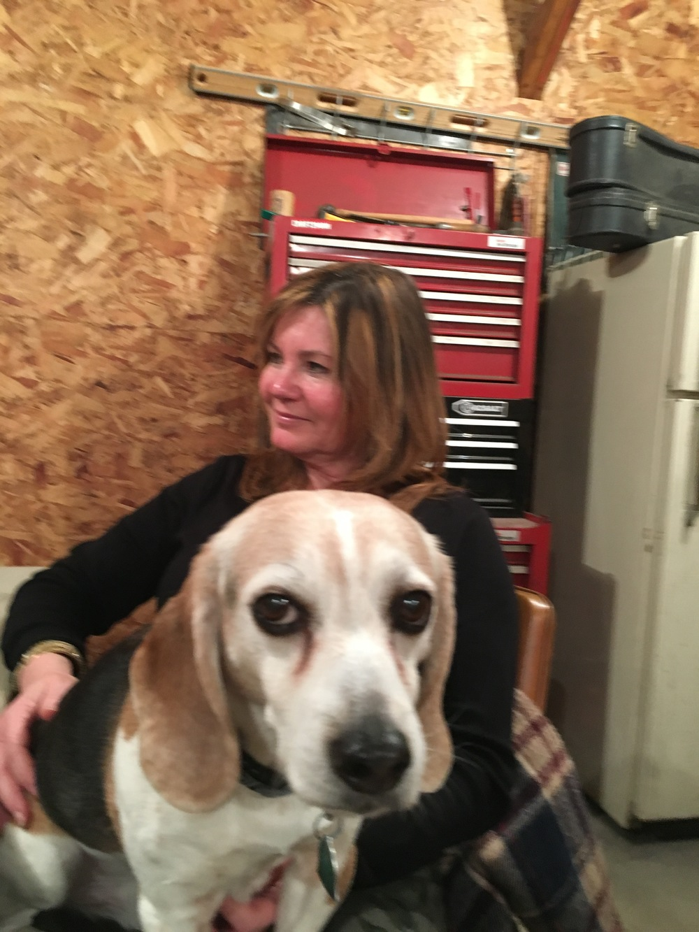 While Tricia would love to tell  you about her three adult children, two grandsons and a little granddaughter, it is Wyatt the beagle whose photo is close at hand.  They are listening to Green Cheese on a Saturday night in Cloverdale.  Life is good.