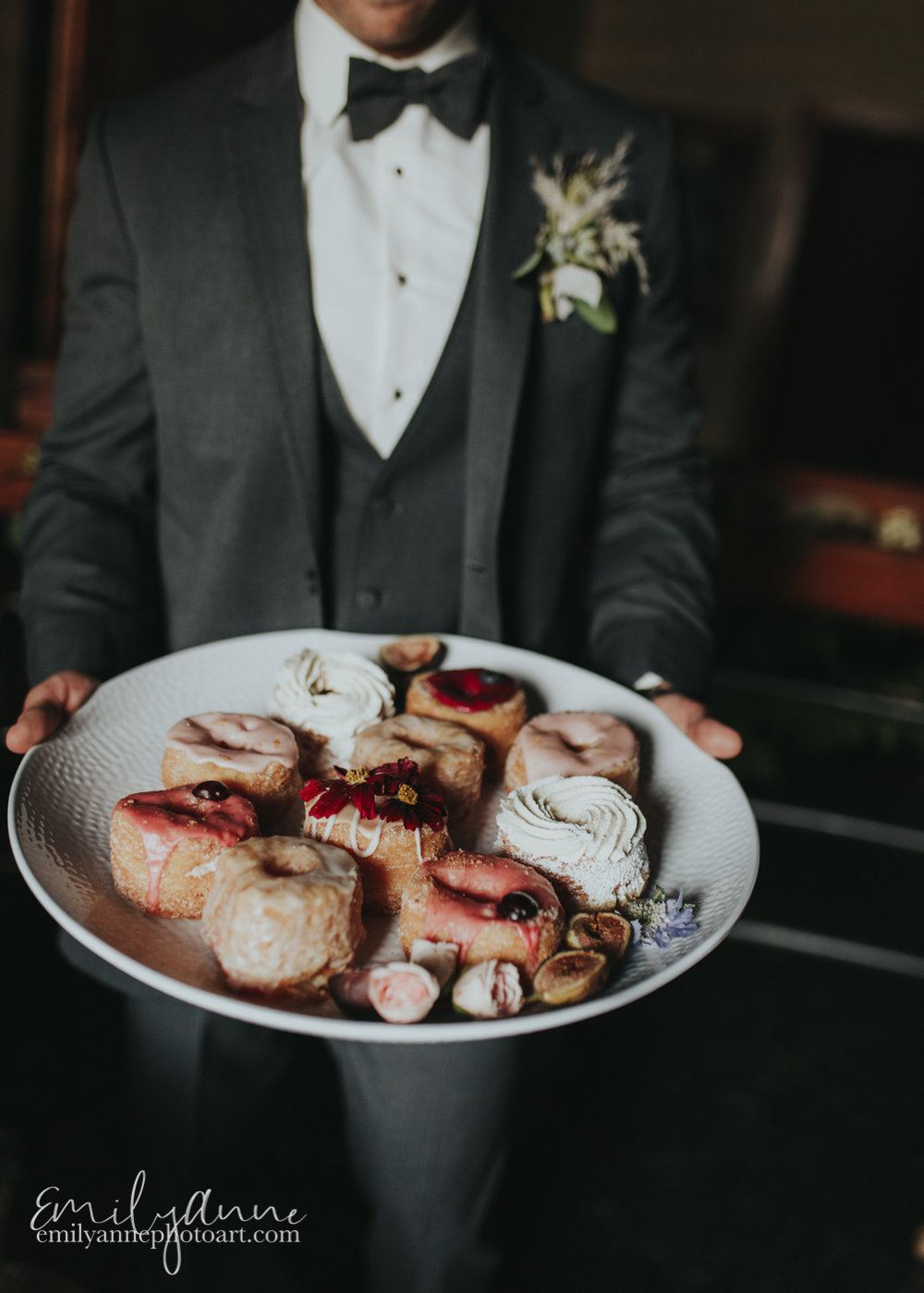 cute idea of groom holding plate of five daughters bakery donuts by top food/wedding photographer in Nashville Emily Anne