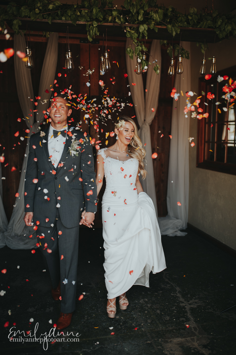 cutest wedding exit throwing petals as the bride and groom leave Foundry Events weddings top Nashville Atlanta and Spain Madrid/Barcelona Wedding Photographer