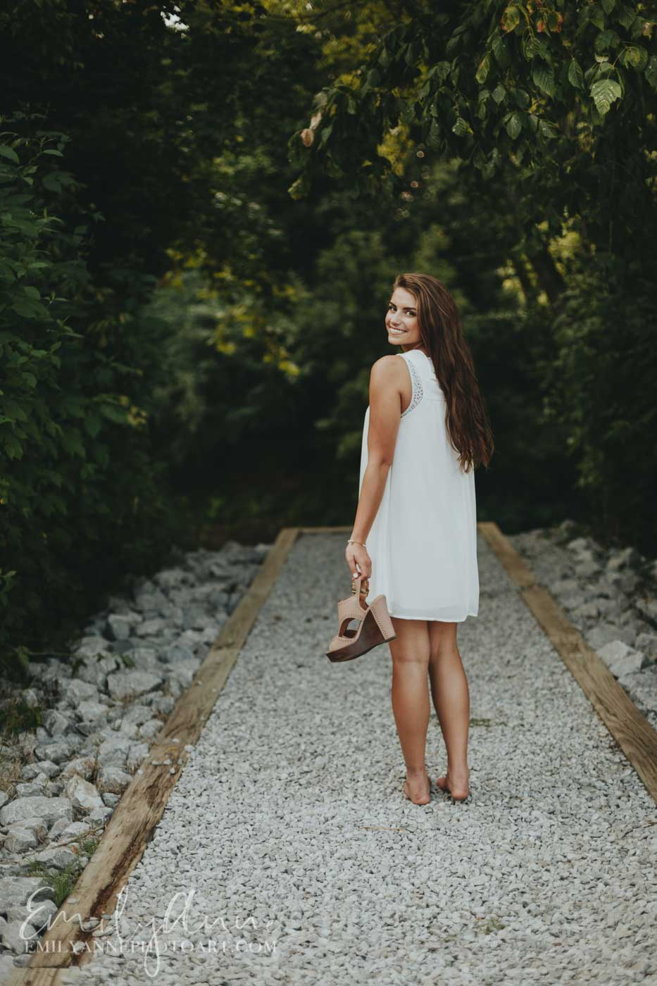 gorgeous outdoors senior portraits at Pinkerton park in Franklin tn by Emily Anne Photo Art (photography)  going into a creek Nashville TN