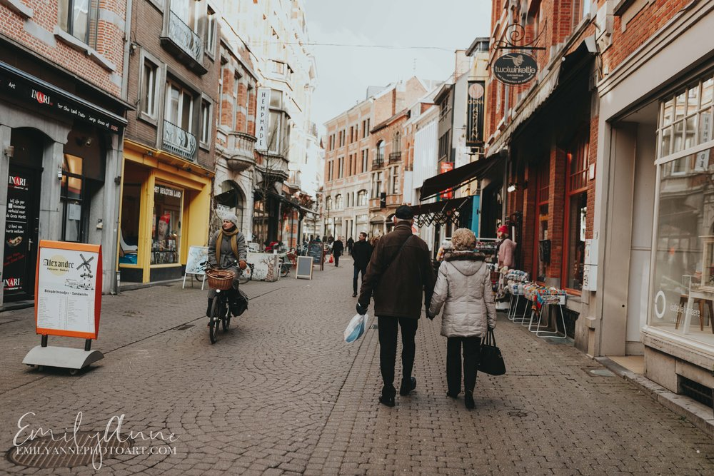 sweet old couple in Leuven Belgium walking down the street great places to retire by top European BelgiumNashville Barcelona photographer Emily Anne Photo Art