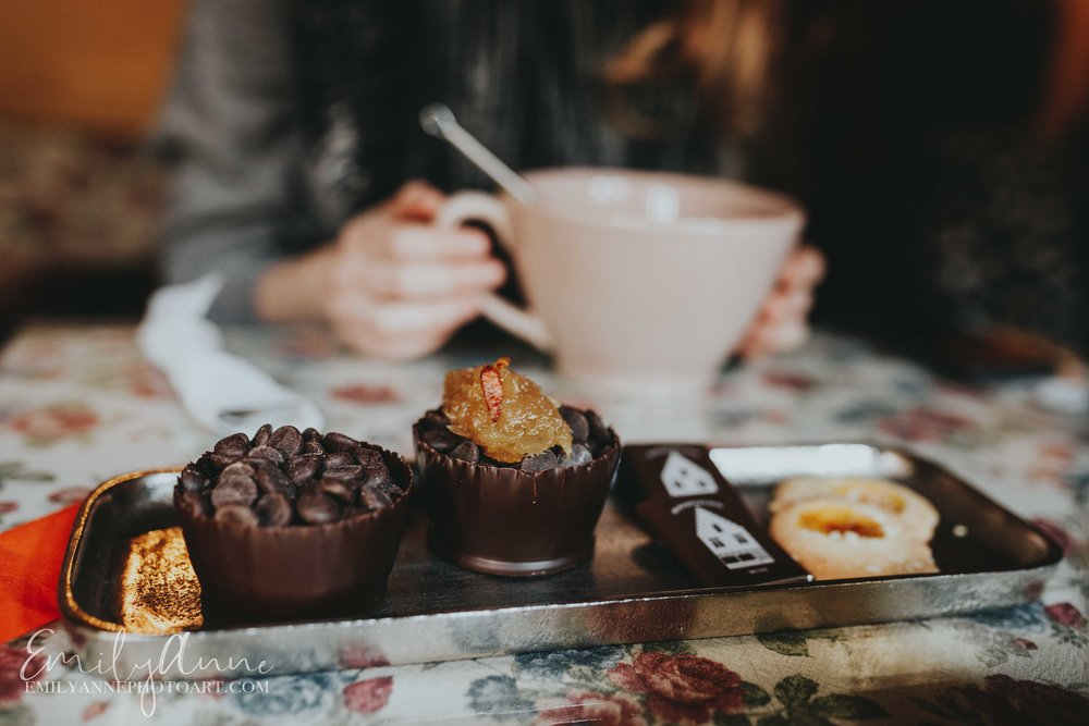 things you must do in Belgium leuven bruges; try a hot chocolate bar with cayenne and honey portraits with chocolate in bruges Belgium the chocolate line by famous chef in Bruges shot by Barcelona Belgium Nashville Leuven Wedding Portrait Lifestyle Photographer Emily Anne