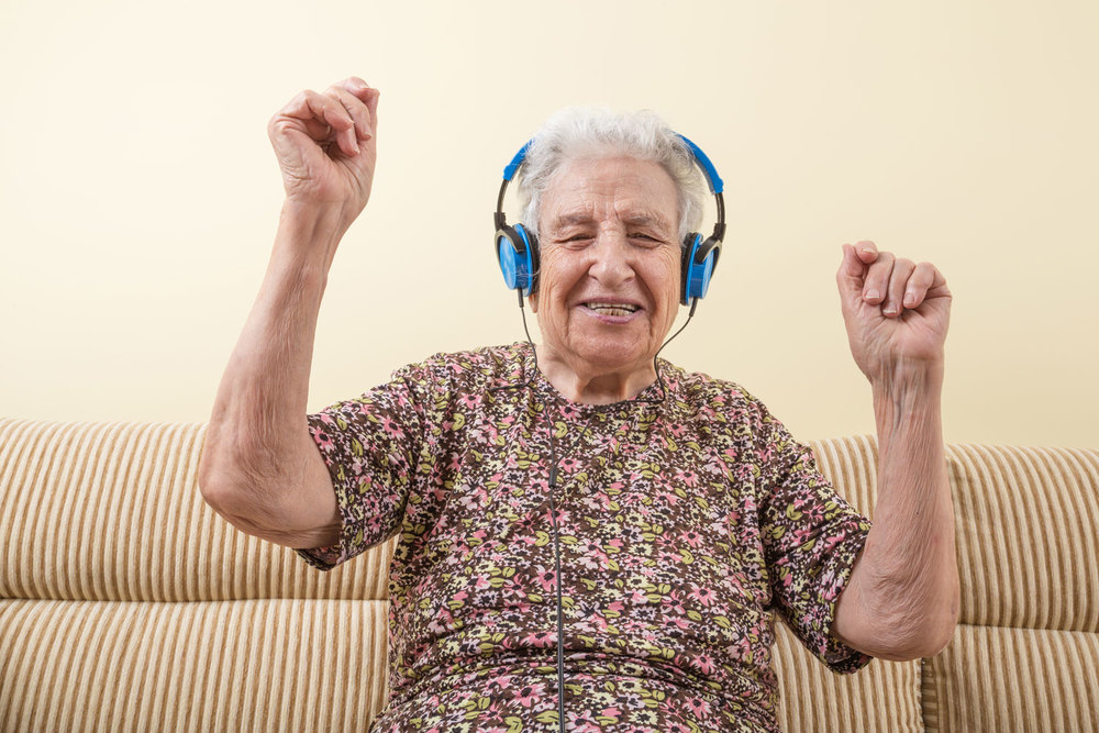 Grandma dancing to tunes with her blue headphones! bella magazine Australia