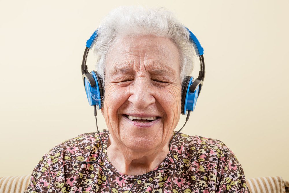 Grandma laughing while listening to music! bella magazine