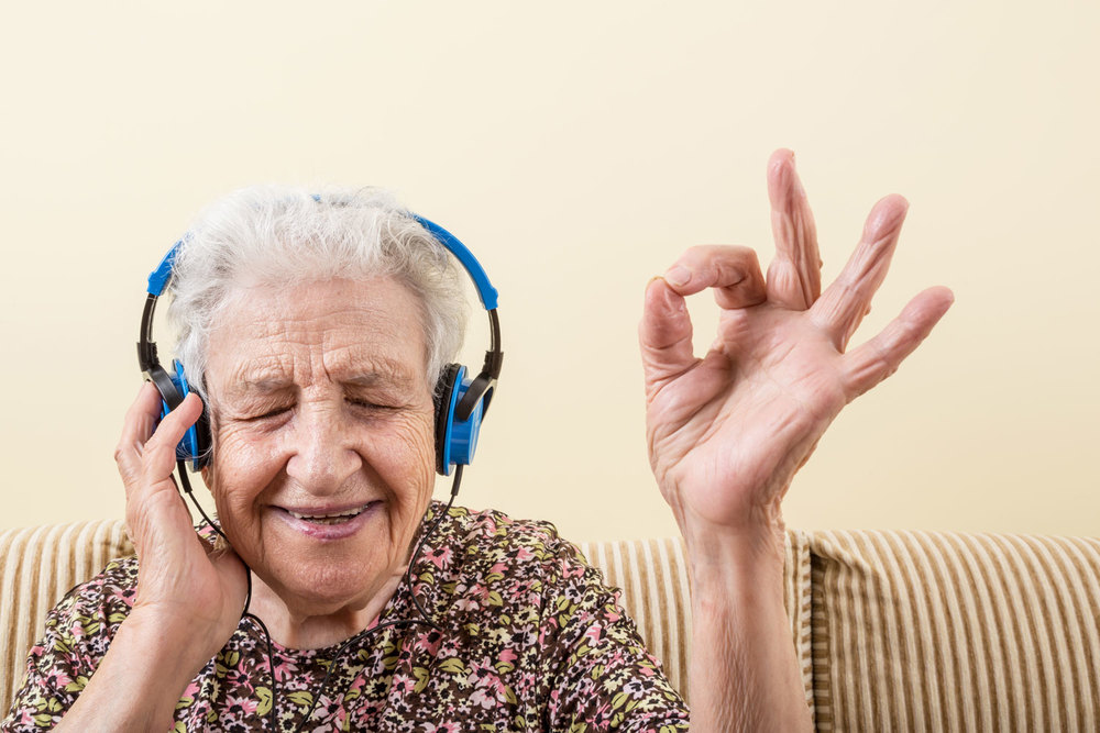 Grandma loving the tunes she is listening too with her massive blue headphones! bella magazine