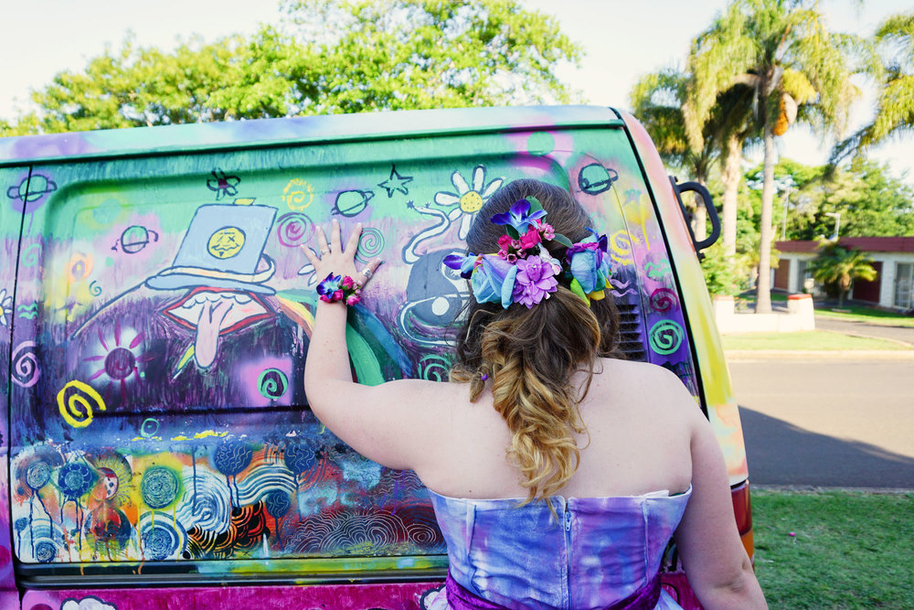 Stunning girl with graffiti van ready for formal.