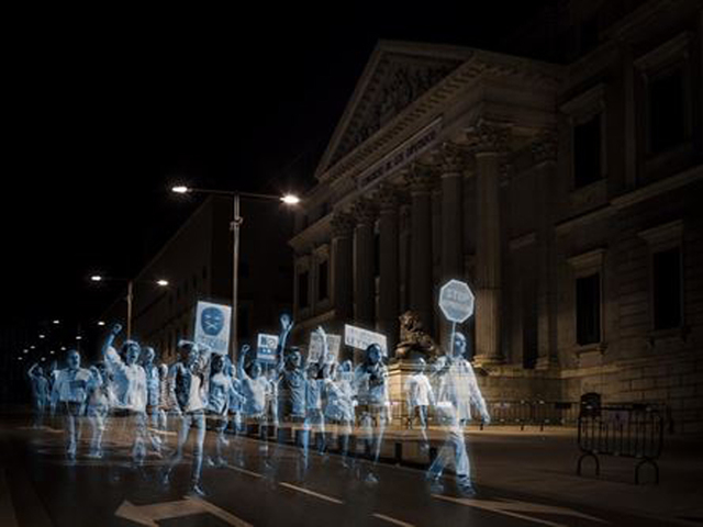 The World's first Hologram protest in front of the Spanish Parliament.  Thousands of holograms staged a protest march against the latest 'gag' laws, which criminalize various forms of protest, including large gatherings outside government buildings.  No Somos Delito (We Are Not Crime) organised this ironic, clever and creative protest.  You can find out more by visiting their website: http://www.hologramasporlalibertad.org/en.html#home