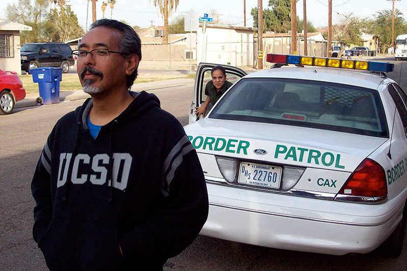 Ricardo_Dominguez_and_Border_Patrol_Agent,_Calexico,_California_2009 (1)_1 (1).jpg