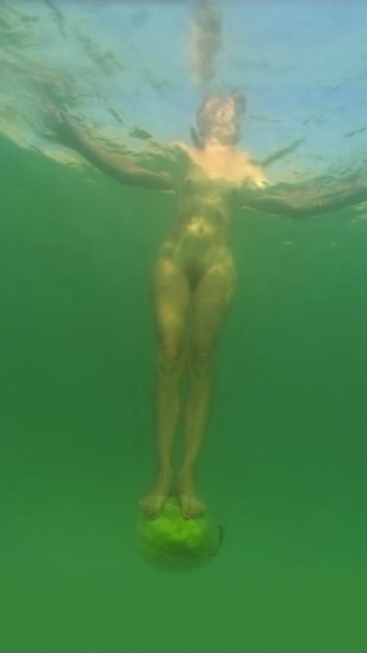 Sigalit Landau, still from  'Standing on a Watermelon in the Dead Sea'  (2005)