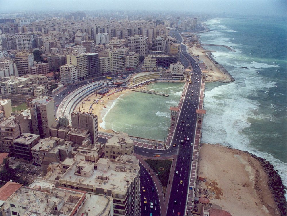 View of the 'corniche' road showing the proximity of the sea waves to the city, and its vulnerability to the coastal implications of climate change. Source: AlexMED, Bibliotheca Alexandrina.